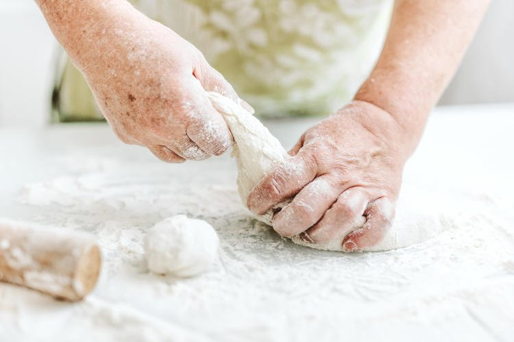 woman-at-home-kneading-dough-for-cooking-pasta-pizza-or-bread-home-cooking-concept-lifestyle