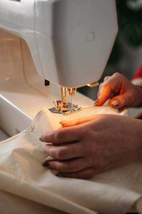 person-using-a-sewing-machine-3738095