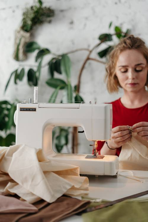 woman-in-red-shirt-sewing-3738103