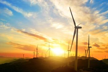Imagen de molinos de viento en un atardecer