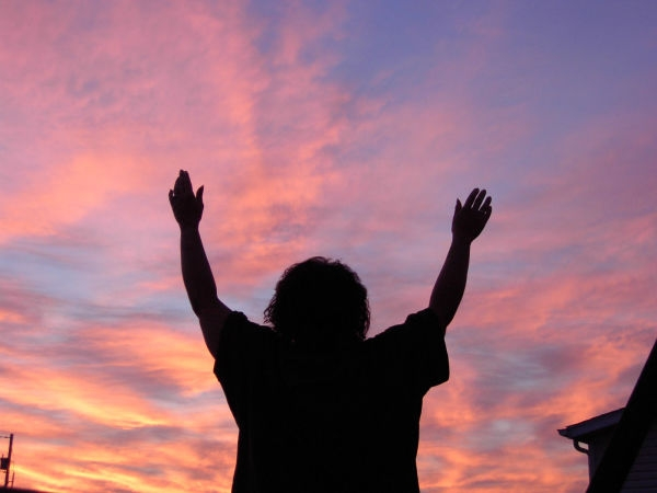 stock arms raised to heaven