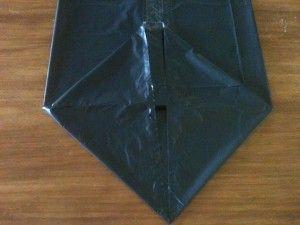 07 - Tomar el doblez anterior, formando una base cuadrada con 2 triángulos como lo muestra la imagen...